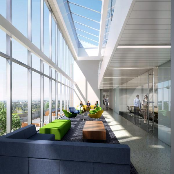 architect's rendering of Bryan Hall interior shows glass window wall, high ceilings, and lots of light